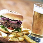Fresh hamburger with beer and fried potatoes